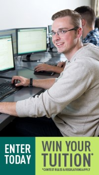 A photo of a software student writing code on a computer