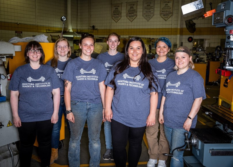 Women in Trades and Technology student group standing for a group photo