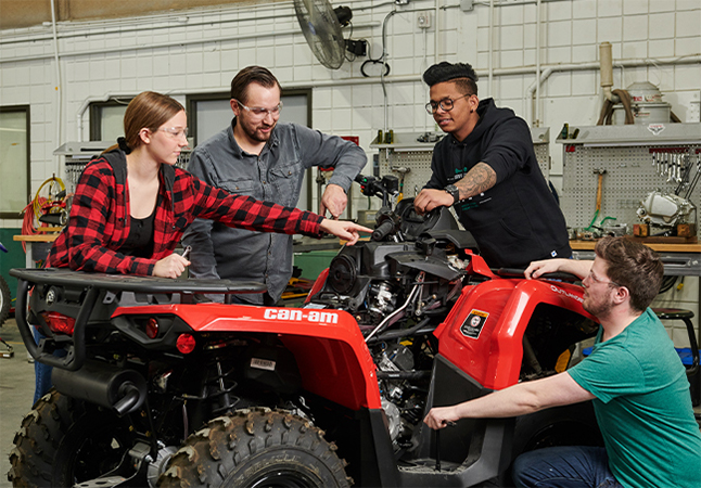 Students working on an All Terrain Vehicle